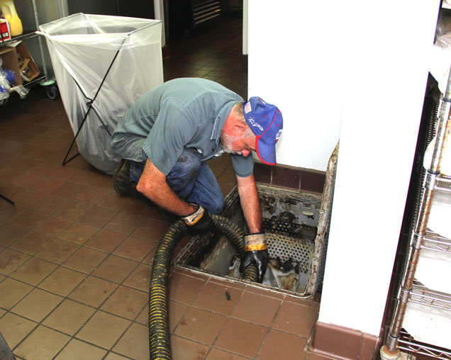 cleaning a clogged grease trap